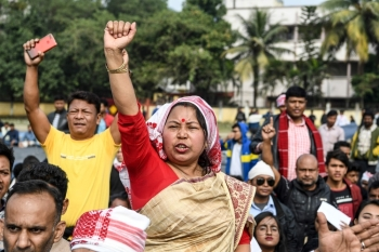 Demonstrators shout slogans during a protest against the government's Citizenship Amendment Bill (CAB) in Guwahati, Assam, on Friday. — AFP
