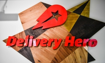 A logo is seen in a lounge area of the global headquarters of online food ordering and delivery giant Delivery Hero in Berlin in this June 27, 2017 file photo. — AFP