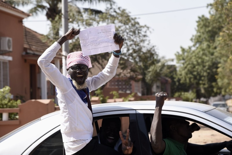 Supporters of newly elected President Umaro Sissoco Embalo celebrate on Wednesday in Bissau after the announcement of the election results.  — AFP