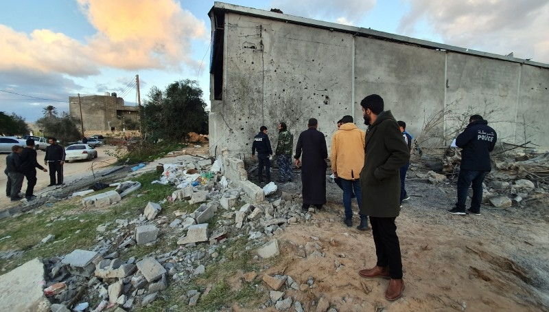 Libyan security members and locals inspect damages on the site of a reported air strike in the capital Tripoli's suburb of Tajoura in this Dec. 29, 2019 file photo. — AFP