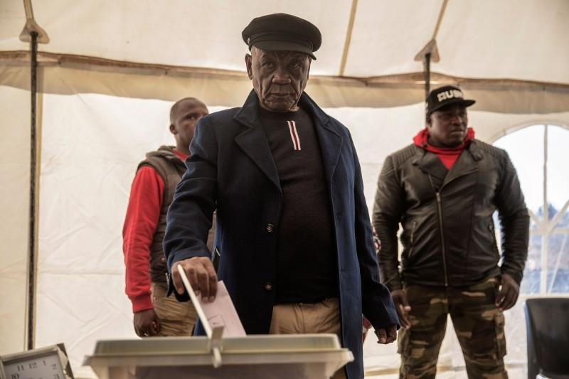 In this file photo taken on June 0, 2017 Lesotho political party All Basotho Convention (ABC) leader and candidate Tom Thabane (C) casts his ballot at a polling station in Maseru, during Lesotho's general election. -AFP