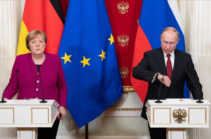 Russia's President Vladimir Putin, right, and Germany's Chancellor Angela Merkel, left, attend their joint press conference after their meeting at the Kremlin in Moscow, in this Jan. 11, 2020 file photo. — AFP