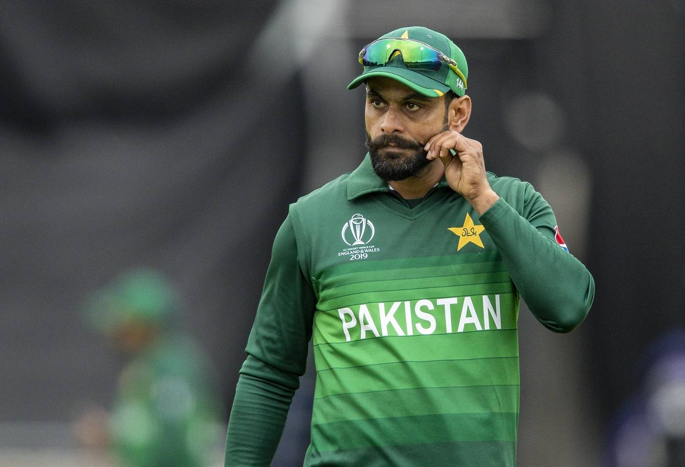 BIRMINGHAM, ENGLAND - JUNE 26: Mohammad Hafeez of Pakistan tweaks his moustache during the Group Stage match of the ICC Cricket World Cup 2019 between New Zealand and Pakistan at Edgbaston on June 26, 2019 in Birmingham, England. (Photo by Andy Kearns/Getty Images)