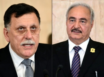 Head of the Tripoli-based Government of National Alliance Fayez Al-Sarraj, left, and Libyan National Army General Khalifa Haftar are seen in this combination file picture. — AFP