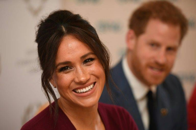 Britain's Prince Harry and his wife Meghan began a new life Sunday as somewhat ordinary people with financial worries and security concerns after being stripped of their royal titles and public funding by the Queen.
