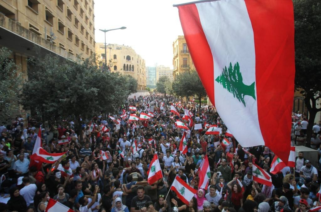Lebanese demonstrators take part in a protest against dire economic conditions in Lebanon's southern city of Sidon in this Oct. 21, 2019 file photo. — AFP