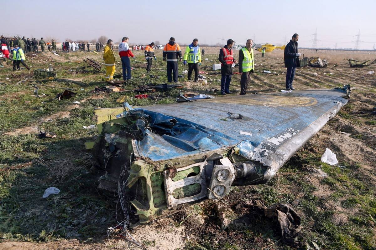 Rescue teams work at the scene of a Ukrainian airliner that crashed soon after take-off near Imam Khomeini airport in Tehran in this file photo. — AFP