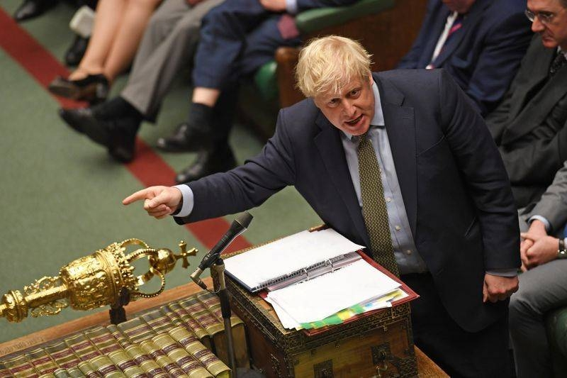 British Prime Minister Boris Johnson, seen speaking in the House of Commons in this file photo, Johnson on Monday suffered his first parliamentary defeat since the election when peers voted to give EU citizens physical proof of their right to stay after Brexit.