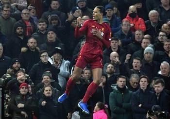 Head and shoulders above the rest: Virgil van Dijk has led Liverpool to a 16-point Premier League lead. — AFP