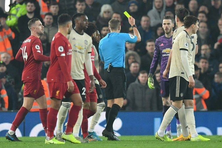 Manchester United have been charged over the conduct of their players in the 2-0 defeat by Liverpool which saw Spanish goalkeeper David de Gea booked. — AFP
