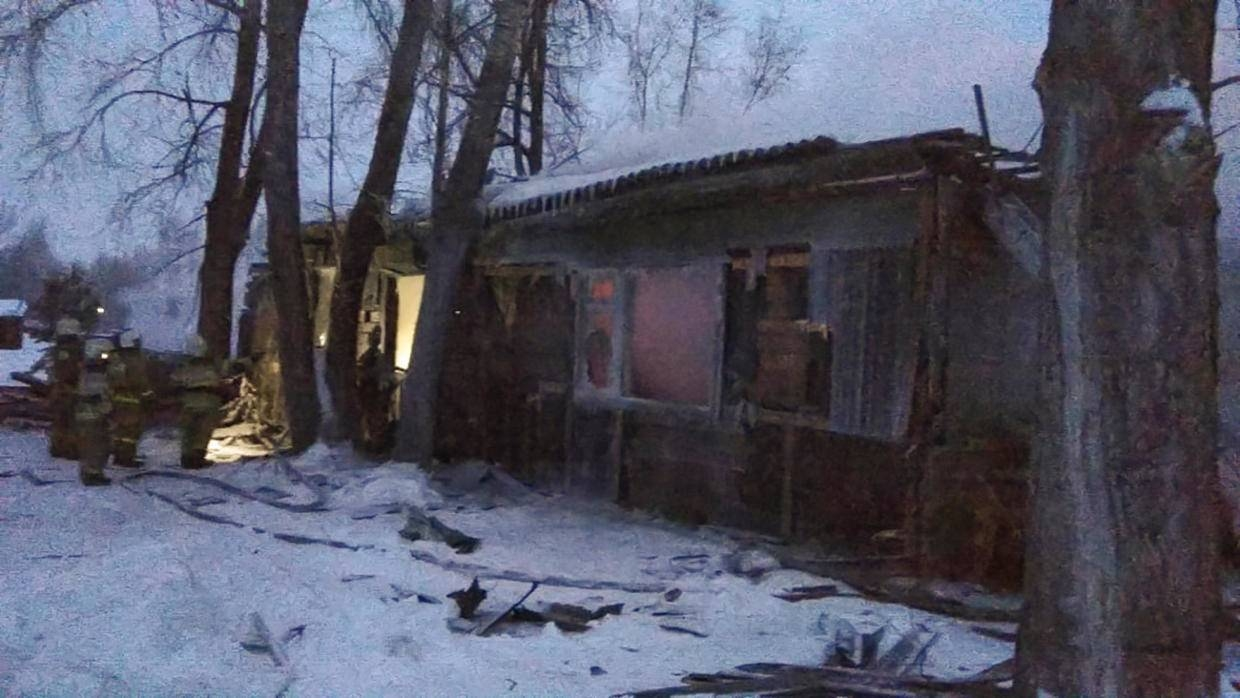 This handout picture released by the Russian Emergencies Ministry shows firefighters working at the site of a fire that broke out in a one-storey wooden shack in the Prichulymsky settlement in Russia's Tomsk region on Tuesday. — AFP