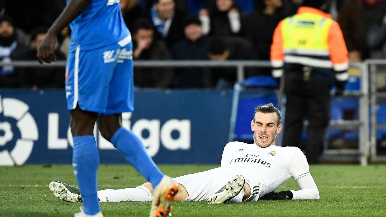 Real Madrid forward Gareth Bale is seen lying on the ground in this file photo. — AFP