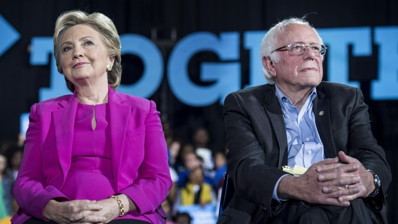 Former US Secretary of State Hillary Clinton, left, and her 2016 Democratic rival Bernie Sanders are seen in this combo file picture. — Courtesy photo