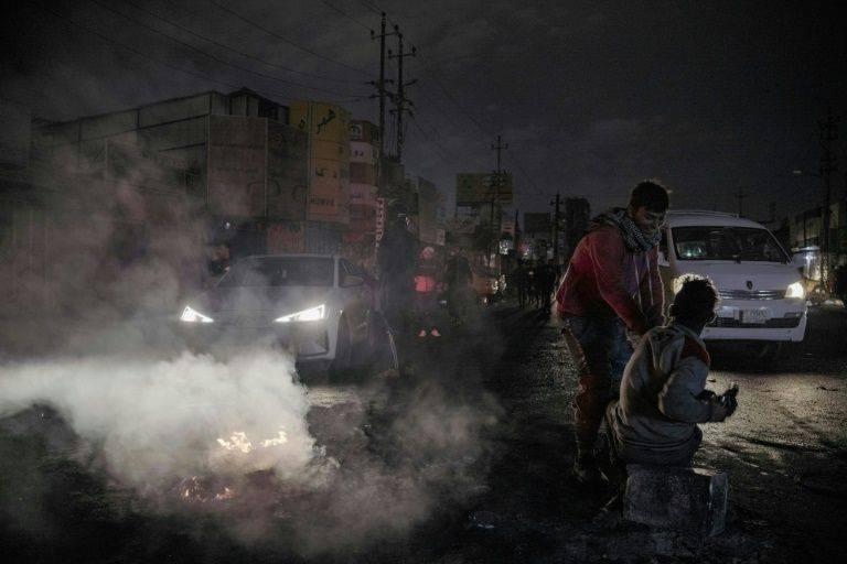 Iraqi youths block a street leading to Baghdad's Al-Tayaran Square, Tuesday. — AFP