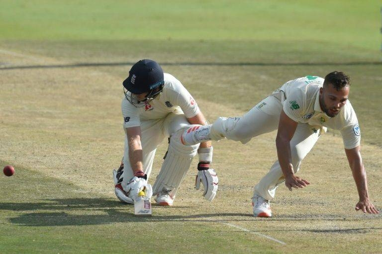 England's Joe Root dives for the crease despite presence of South Africa's Dane Paterson. — AFP