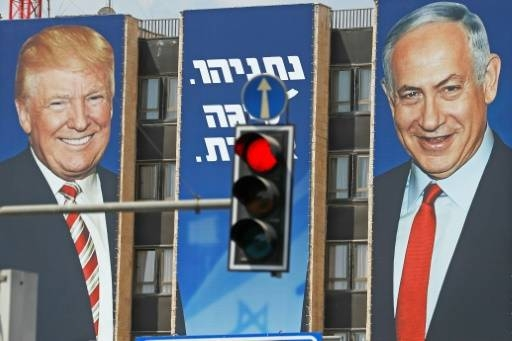 An Israeli election banner bears the portraits of US President Donald Trump, left, and Prime Minister Benjamin Netanyahu hanging on a building facade in Jerusalem in this September 14, 2019 file photo. — AFP