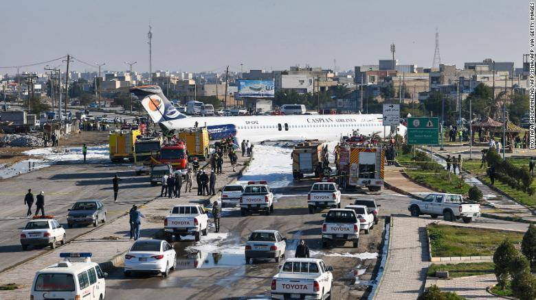 A Caspian Airlines aircraft landed on a highway after it overshot the runway in Mahshahr, Monday. — AFP