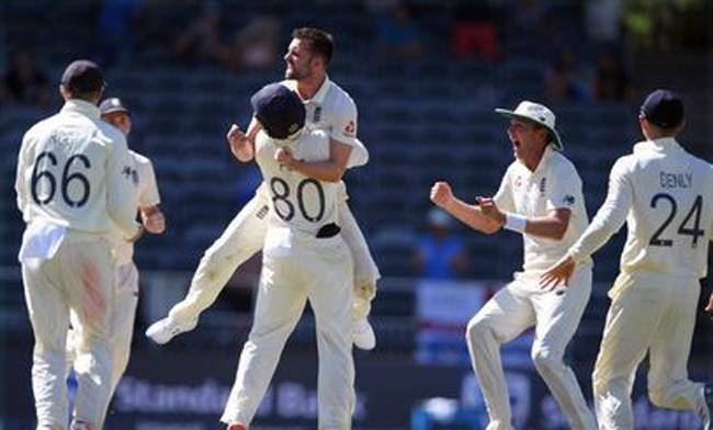 England players celebrate after completing a 3-1 series victory with a 191-run win in the fourth and final Test against South Africa at the Wanderers Stadium on Monday.