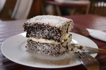 Lamingtons, a traditional Australian dessert, are cube-shaped sponge cakes dipped in chocolate and covered in grated coconut. — Courtesy photo
