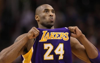 Basketball legend Kobe Bryant's death in a helicopter crash along with his teenage daughter sparked an outpouring of grief across the worlds of sports and entertainment on Monday.