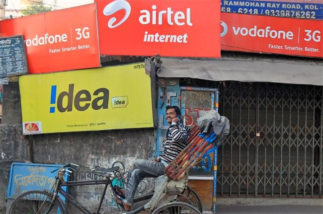 File photo of hoardings advertising the telecom services.