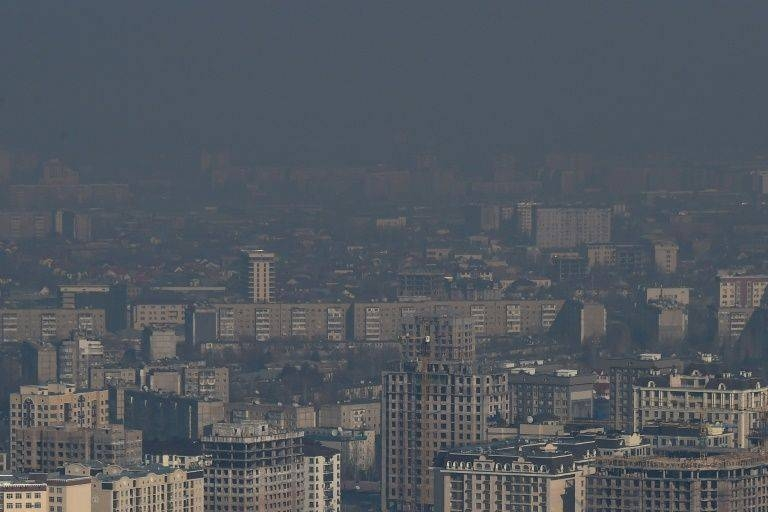 A heavy cloud of dark smog often blots out the view of snow-capped mountains in the Kyrgyz capital of Bishkek. — AFD