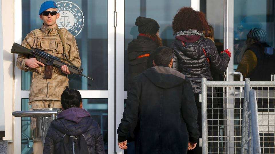 A soldier stands near a barricaded entrance of the Silivri courthouse, before the trial of leading members of Turkish civil society, in Silivri, outside Istanbul, Tuesday. — Courtesy photo