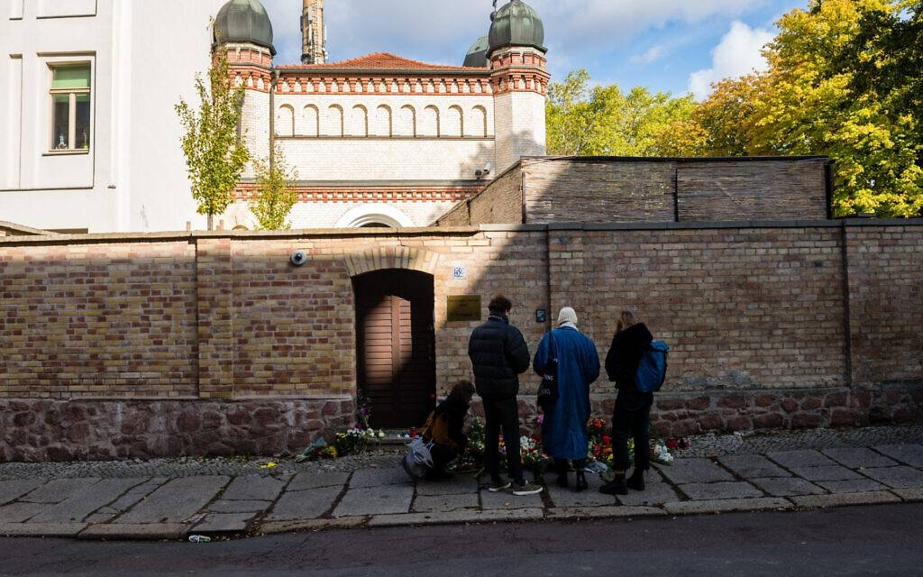 People mourn in front of the entrance to the Jewish synagogue in Halle, Germany, in this Oct. 10, 2019 file picture. — Courtesy photo