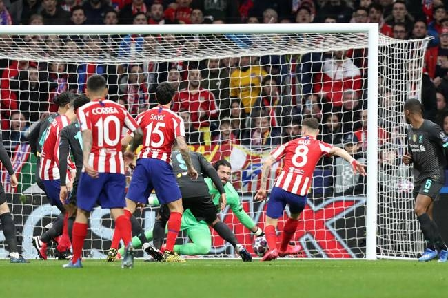Saul Niguez (No.8) of Atletico de Madrid scores the winning goal against Liverpool. — AFP
