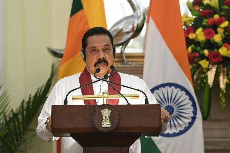 Sri Lanka Prime Minister Mahinda Rajapaksa said the country was withdrawing from a United Nations resolution to investigate war crimes. — AFP