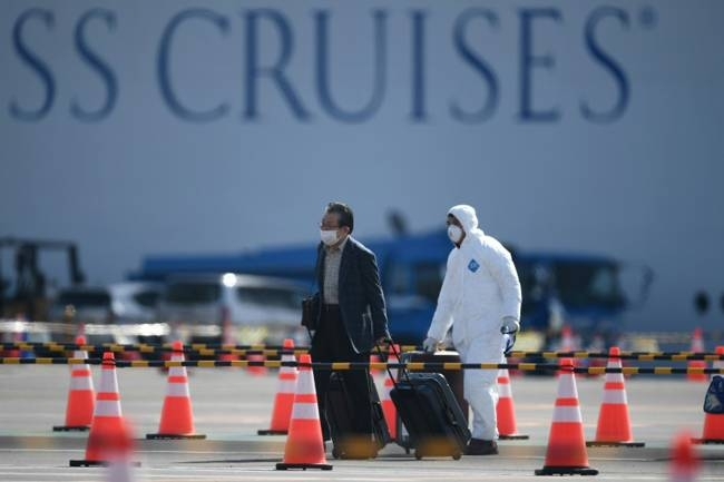 There are worries over allowing former Diamond Princess passengers to roam freely around Japan's notoriously crowded cities, even if they have tested negative for the coronavirus. — AFP