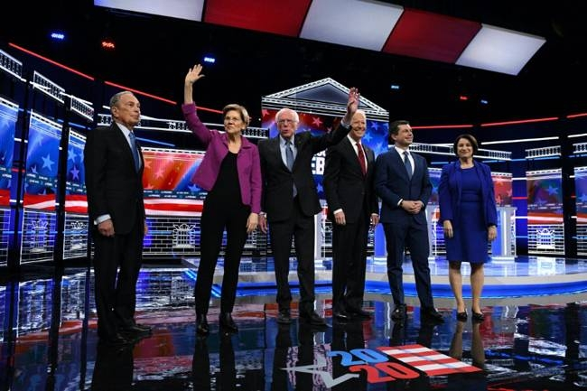 US presidential hopeful Mike Bloomberg (L), the former mayor of New York, joined his fellow Democrats on stage for the first time for their ninth debate of the party's nomination process on Wednesday. — AFP