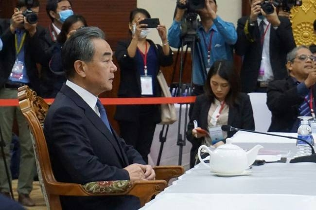 Chinese Foreign Minister Wang Yi (L) says his country's efforts to control the coronavirus outbreak are working. — AFP