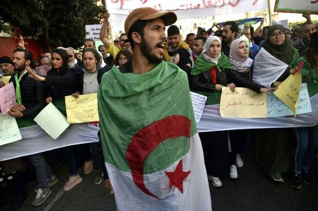 Algerian students and other protesters take part in an anti-government demonstration in the capital Algiers, on Feb. 18. — AFP