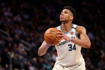 Milwaukee Bucks star Giannis Antetokounmpo shoots a free throw while playing the Detroit Pistons during the second half at Little Caesars Arena in Detroit. — AFP