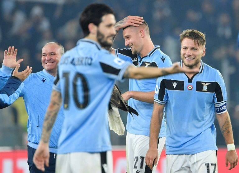 Serie A top scorer Ciro Immobile, right, scored his 27th league goal this season. — AFP