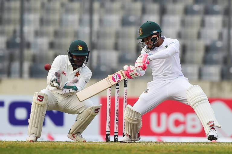 Bangladesh's Mushfiqur Rahim plays a shot as Zimbabwe's Regis Chakabva keeps wicket on the second day of their Test at the Sher-e-Bangla National Cricket Stadium in Dhaka. — AFP