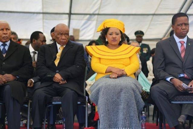 Lesotho Prime Minister Thomas Thabane, second left, and his future wife, Maesaiah Thabane, second right, attend his inauguration, two days after his wife's murder in this 2017 file photo. — AFP