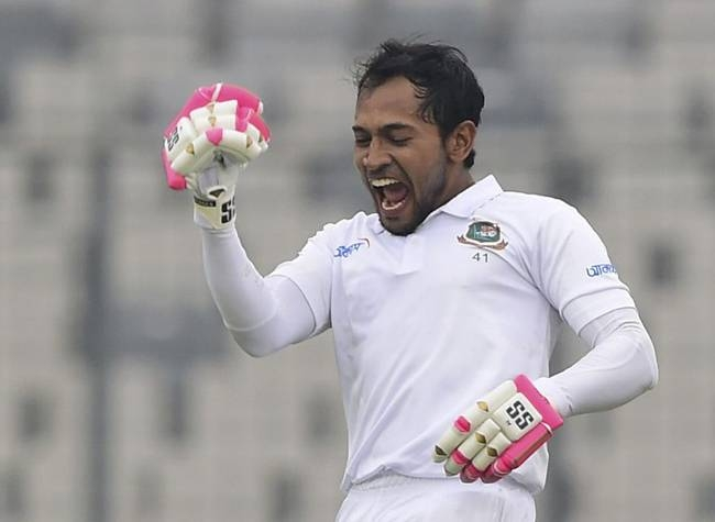 Bangladesh's Mushfiqur Rahim reacts after scoring a double century (200 runs) during the third day of a Test cricket match between Bangladesh and Zimbabwe at the Sher-e-Bangla National Cricket Stadium in Dhaka on Monday. — AFP