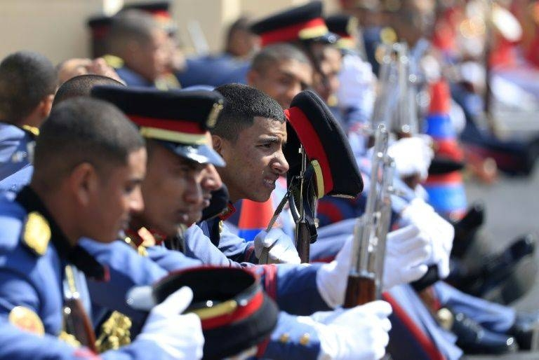 Honor guards wait as they attend Mubarak's funeral.