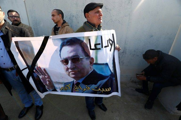 Hosni Mubarak supporters gather outside Cairo's Mosheer Tantawy Mosque.