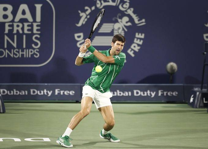 Novak Djokovic won his 16th match of an undefeated season, hammering Russia's Karen Khachanov 6-2, 6-2 on Thursday for a place in the Dubai Championships semifinals.