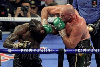 Tyson Fury's promoter wants Deontay Wilder (left) to waive his right to another bout between the rivals. — AFP