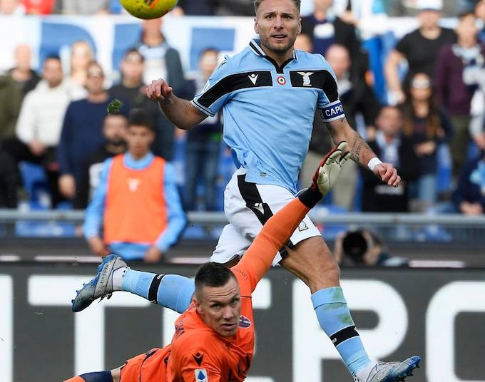 Lazio moved top of Serie A on Saturday with a 2-0 victory over Bologna as five matches were postponed in the Italian top flight due to fears over the coronavirus.