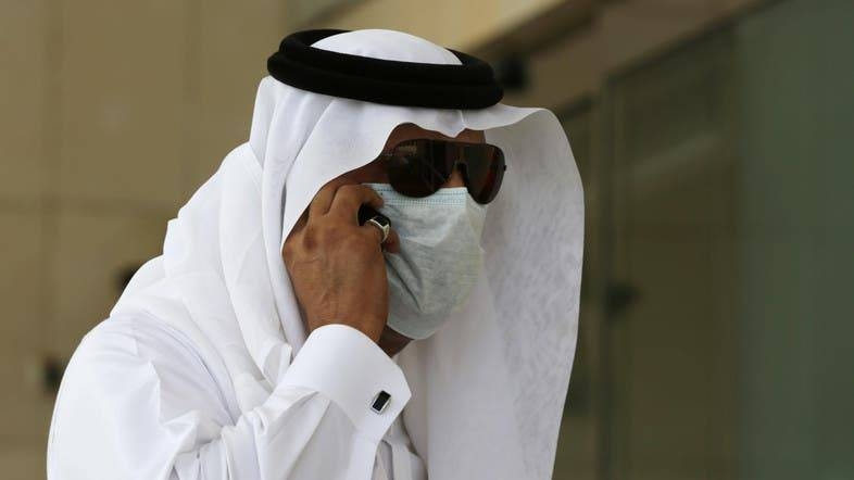 A Saudi man wears a mask and talks on his phone outside King Fahd hospital in Jeddah. — Archives