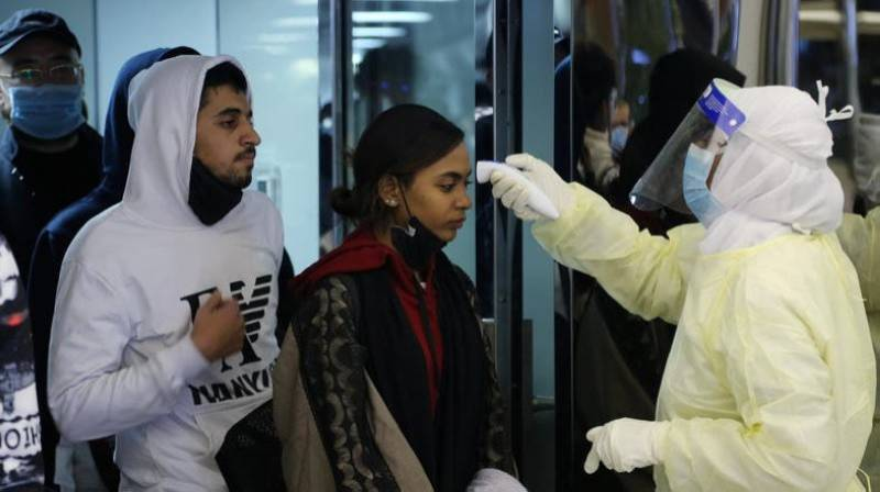 Passengers wearing masks to prevent a new coronavirus are checked by Saudi Arabia's Health Ministry employees upon their arrival at King Khalid International Airport, in Riyadh. — File Photo