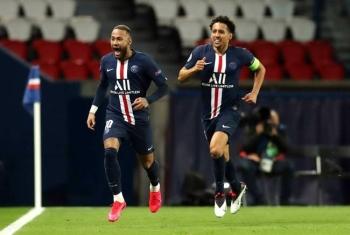 Neymar celebrates putting PSG ahead against Borussia Dortmund as captain Marquinhos gives chase. — AFP