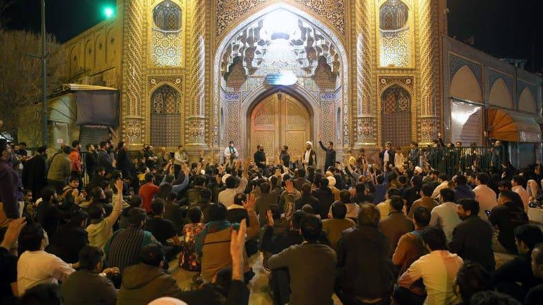 People gather outside the closed doors of the Fatima Masumeh shrine in the Shiite city of Qom, Monday. - Courtesy photo