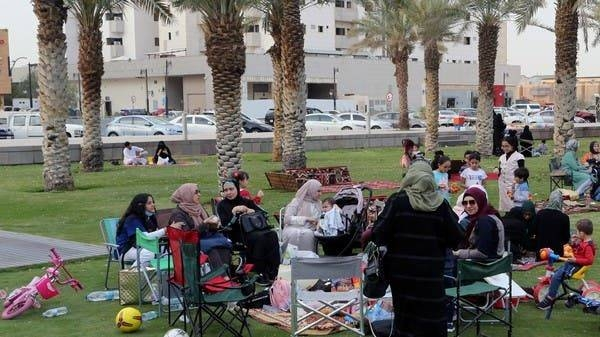 Visitors sit in the garden of the King Fahd Library in Riyadh, ignoring the government directive against social gatherings. — Courtesy photo