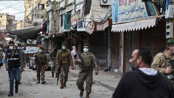 Lebanese security forces enforce an order to shut shops in Sabra, southern Beirut, Sunday. -- Courtesy photos